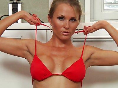 Topless kirmess MILF Laura Crystal drops on her knees to blow