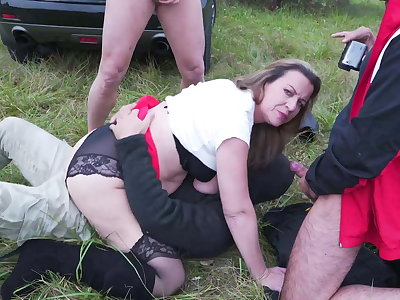 Mature mother fucks in all holes outdoor