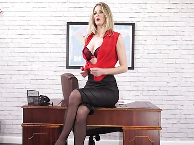 Quite nicely shaped Leah is office nympho who loves massaging her boobies