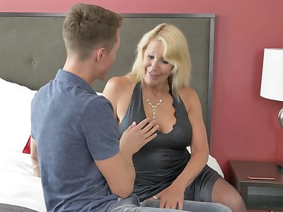 Mature blonde floozy Bianca J. with regard to stockings teaching a younger guy