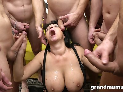 Surrounded by cocks the busty mature goes full doing